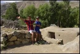 Tusion, Tajik mountains: behind Muiz Sharopov, a traditional Pamiri house © Bernard Grua
